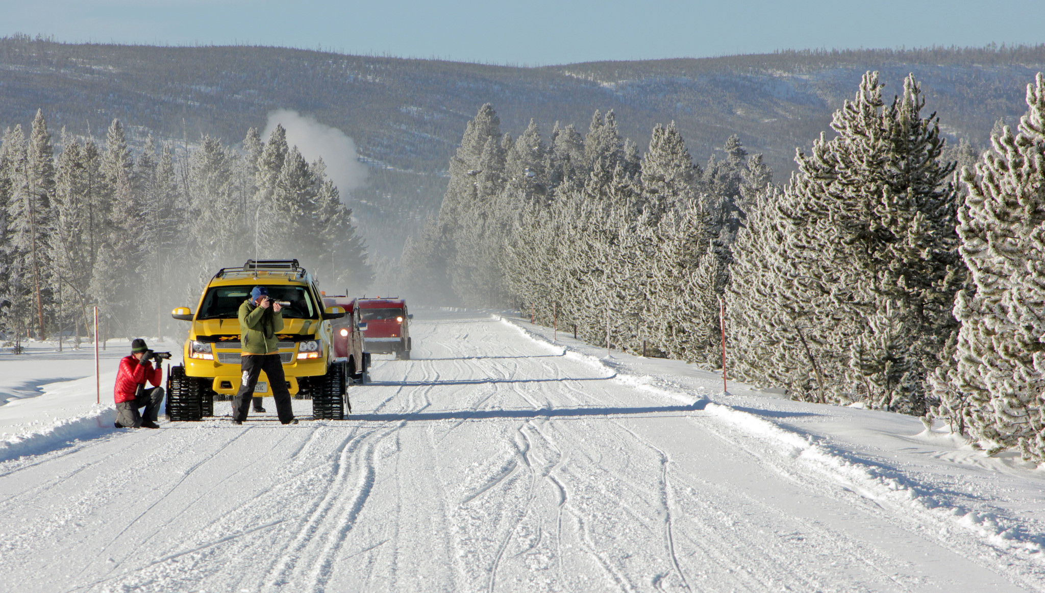 Experiencing Yellowstone by Snowcoach is the ideal way to see this timeless national park in winter ... photo by CC user yellowstonenps on Flickr