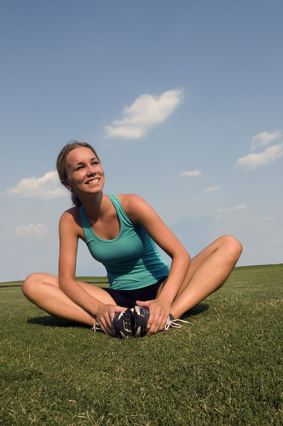15313-a-healthy-young-woman-stretching-outdoors-pv