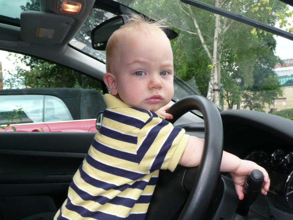 little-2-years-old-boy-drives-a-car-1454883614pCw